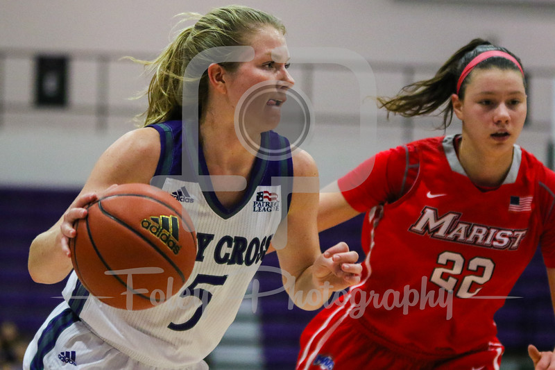 Holy Cross Crusaders guard Katie Doherty (5) Marist Red Foxes forward Morgan Bartner (22)