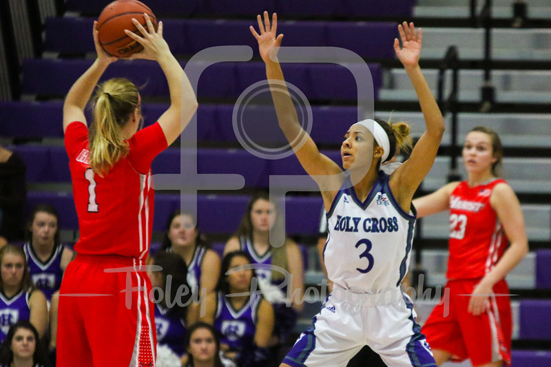 Marist Red Foxes guard Claire Oberdorf (1) Holy Cross Crusaders guard Infiniti Thomas-Waheed (3)