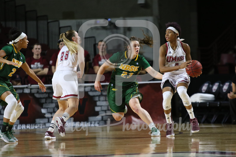 North Dakota State Bison guard Kennedy Childers (23) Massachusetts Minutewomen guard Ryan Holder (2)