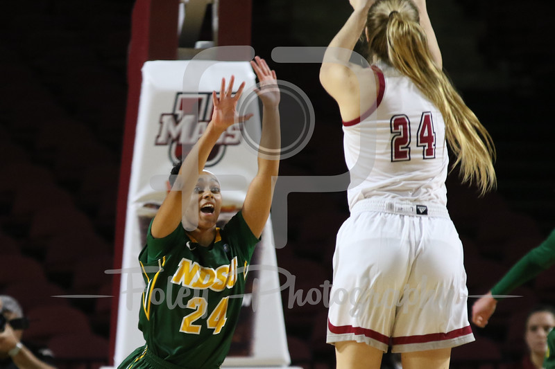 North Dakota State Bison guard Tyrah Spencer (24) Massachusetts Minutewomen guard/forward Hailey Leidel (24)