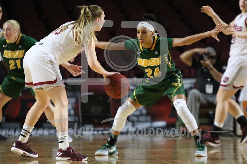 North Dakota State Bison guard Tyrah Spencer (24) Massachusetts Minutewomen forward/center Maggie Mulligan (00)