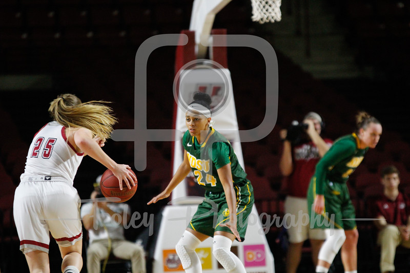 North Dakota State Bison guard Tyrah Spencer (24) Massachusetts Minutewomen guard Leah McDerment (25)
