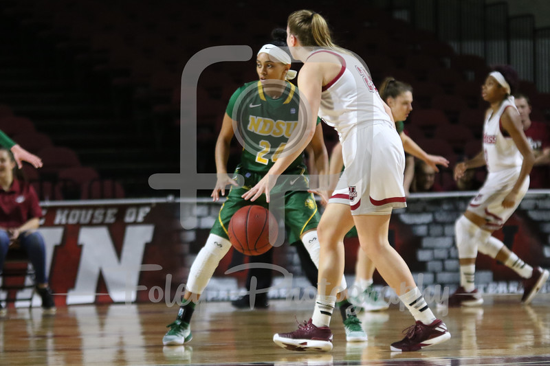 Massachusetts Minutewomen forward/center Maggie Mulligan (00) North Dakota State Bison guard Tyrah Spencer (24)
