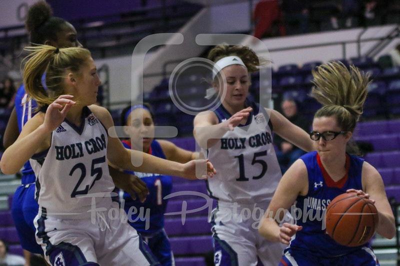 Holy Cross Crusaders guard/forward Madelyn Ganser (15) Holy Cross Crusaders forward Lauren Manis (25)