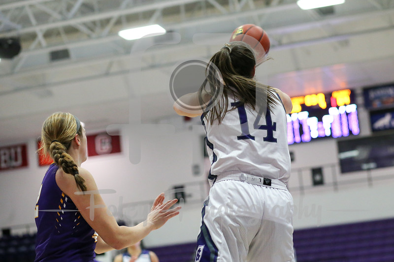 Kathryn Pedi (14) of the Holy Cross Crusaders
