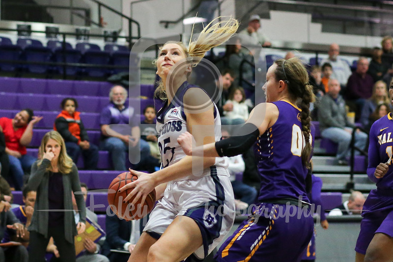 Lauren Manis (25) of the Holy Cross Crusaders Mackenzie Trpcic (00) of the Albany Great Danes