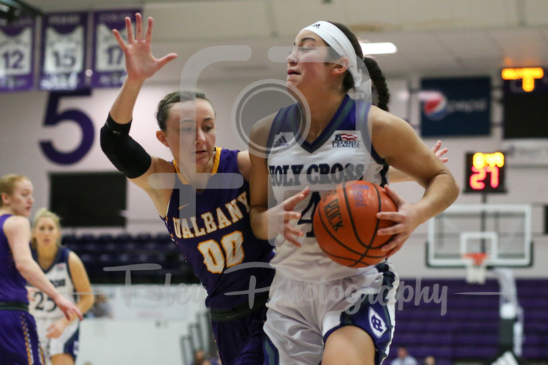 Jenay Faulkner (4) of the Holy Cross Crusaders Mackenzie Trpcic (00) of the Albany Great Danes