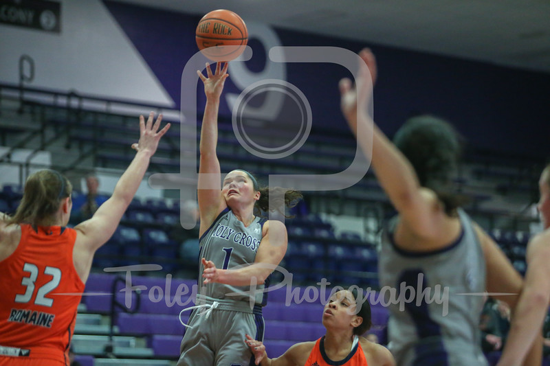 Holy Cross Crusaders guard Tricia Byrne (1) Bucknell Bison forward Catherine Romaine (32)