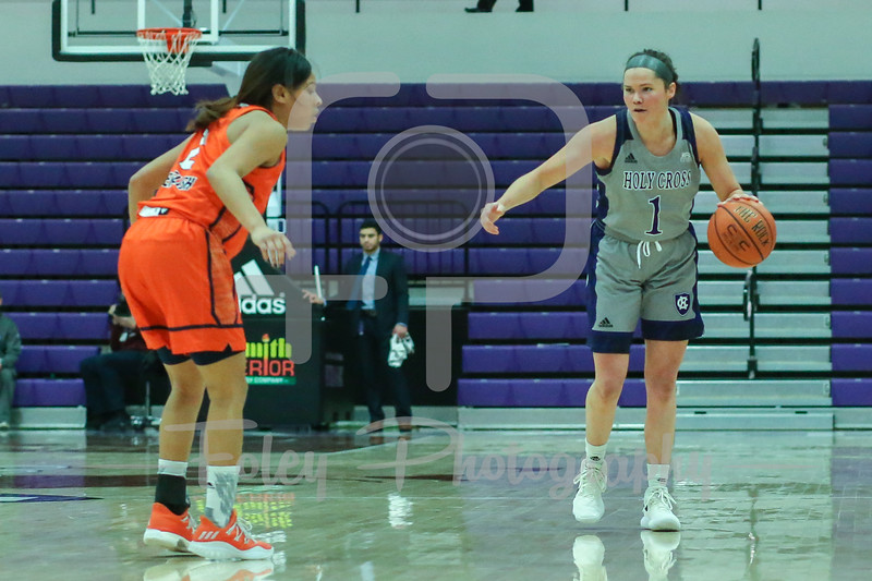 Holy Cross Crusaders guard Tricia Byrne (1) Bucknell Bison guard Kyi English (2)