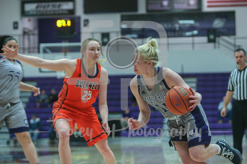 Holy Cross Crusaders guard Shannon Druck (11) Bucknell Bison guard Abby Kapp (25)
