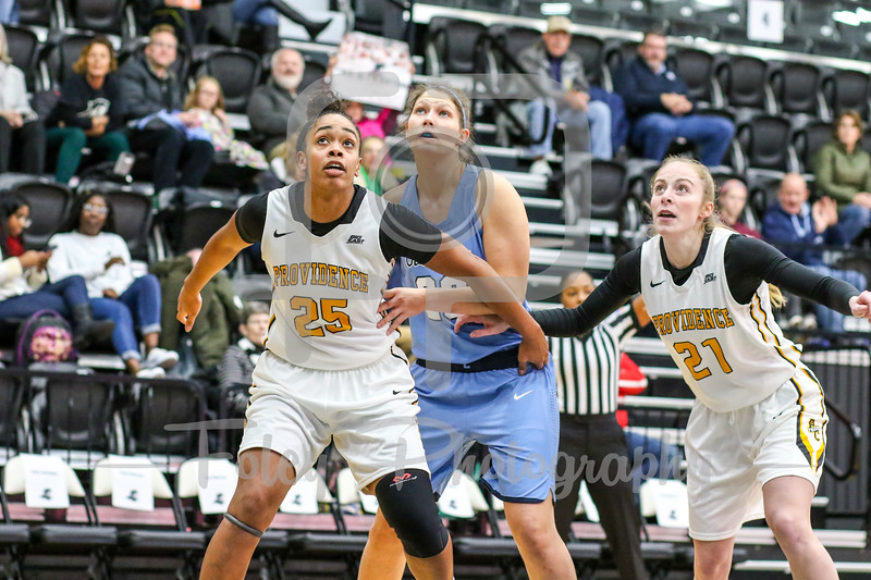 Providence Lady Friars forward Brianna Frias (25) Columbia Lions guard/forward Camille Zimmerman (20)
