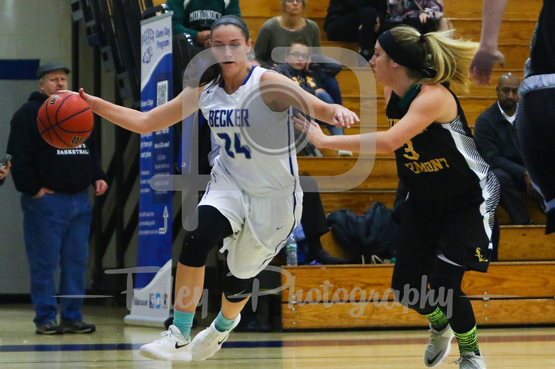 Becker College Hawks forward Ciara McKissick (24) Southern Vermont Mountaineers Kayla Emmi (3)