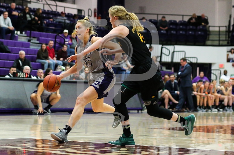 Holy Cross Crusaders forward Lauren Manis (25) Vermont Catamounts forward Hanna Crymble (10)