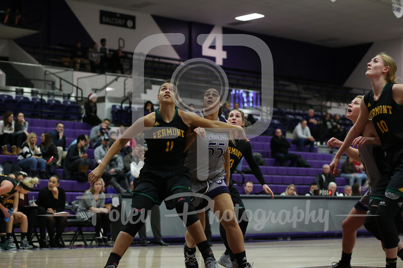 Holy Cross Crusaders center Miranda Nixon (55) Vermont Catamounts forward Candice Wright (11)