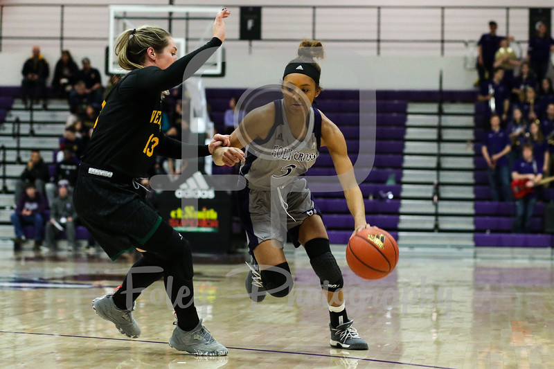 Holy Cross Crusaders guard Infiniti Thomas-Waheed (3) Vermont Catamounts guard Kristina White (13)