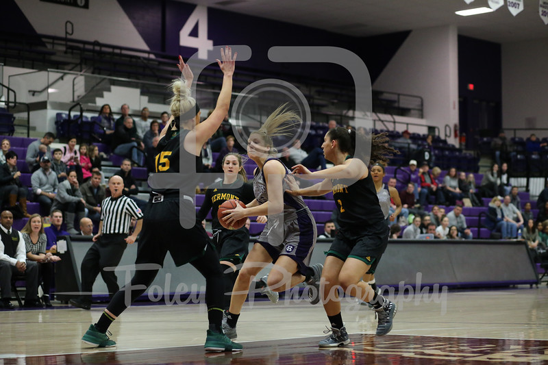 Holy Cross Crusaders forward Lauren Manis (25) Vermont Catamounts forward Cassidy Derda (15)