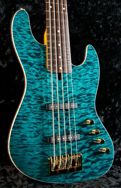 J5 bent Top Bass, #3259 Trans Turquoise, Grosh Vintage JJ Pickups, Hipshot Bridge, and Keys.