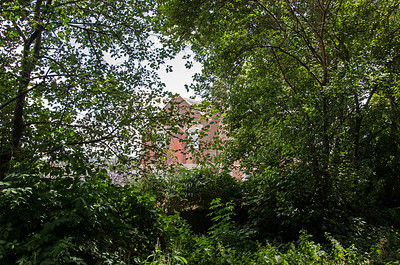 Through the trees can be seen the old warehouse situated next to the old co-op siding. I believe this may have been the bakery. It is clearly visible in old photographs of this area. The S&D ran on the level past here before resuming the 1 in 50 climb.