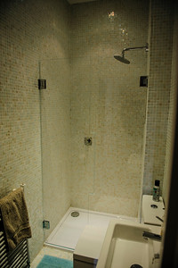 Custom made glass shower doors, area had to be templated for exact sizing of glass.