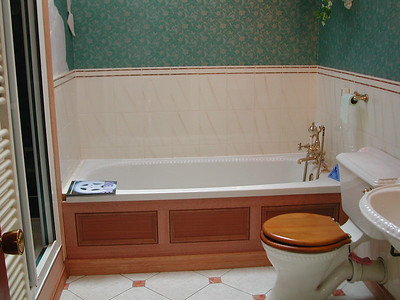 New custom made hardwood bath panel, panel behind toilet hinged to allow access to trap and stop cock.