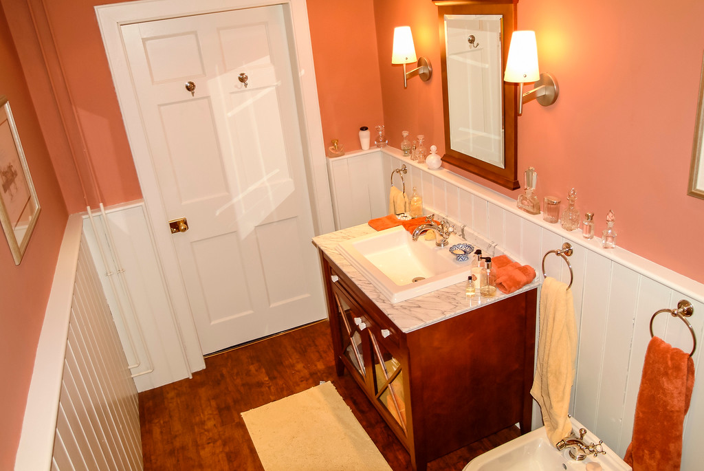 New town bathroom with marbel bath panel and shower shelf.