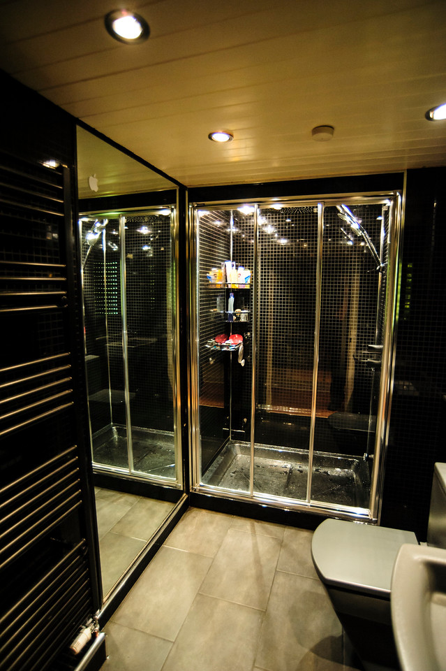 Black wet wall round entire shower room