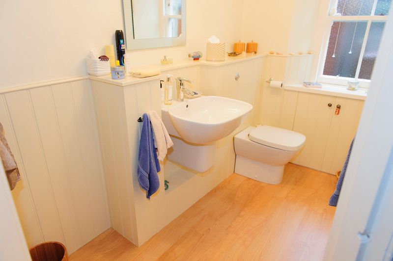 Small cloakroom beaded lining round room.