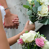 hands and wedding bouquets