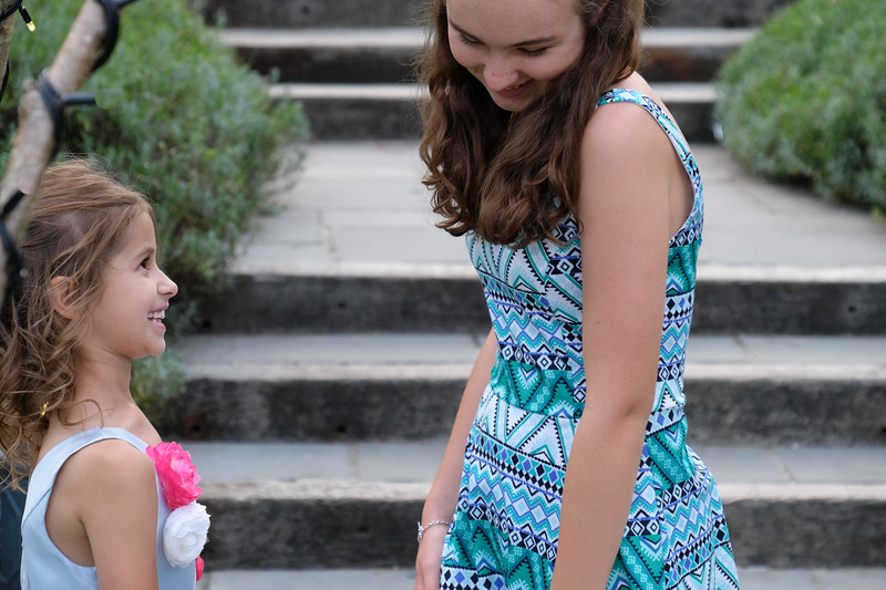 bridesmaid shares a nice moment with an older friend