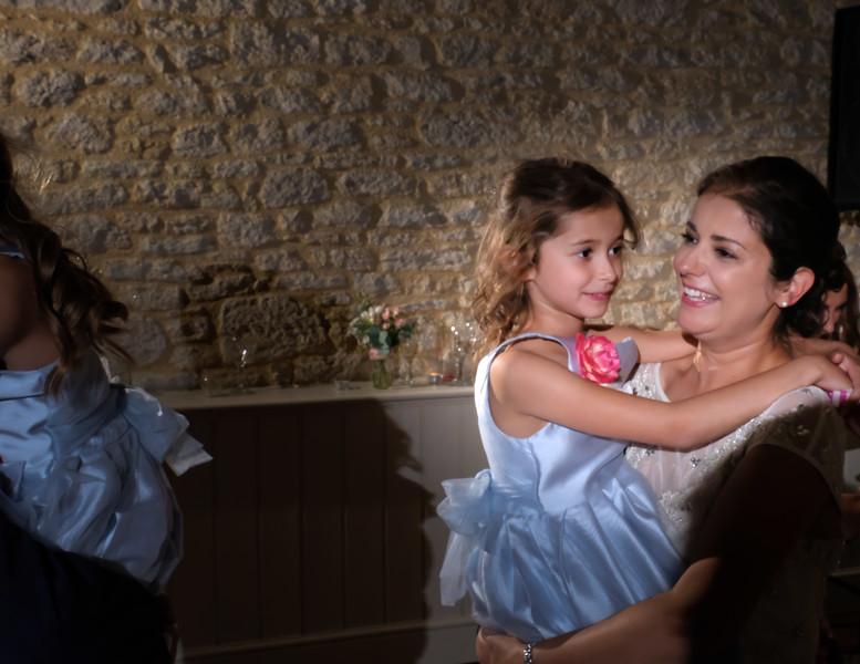 daughter and mum happy at evening wedding receptiom