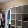 Arch entry into the closet, nice shoe rack