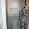 After Picture:<br /> Removed wallpaper, re-painted, new toilet, new tile, new baseboards, new towel bars, and removed entry door.