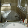 We removed the high knee wall that was between the old tub and shower, providing more openness to showcase your new tile!