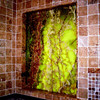 A Backlit Green Onyx Bathroom Window by Schlitzberger Stone Designs