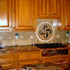 Kitchen Tops and Dolphin-Themed Tile Art in Blue Fusion Granite by Schlitzberger Stone Desgins