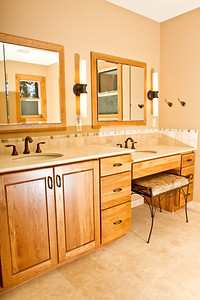 Seated vanity with lowered countertop.
