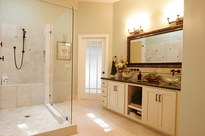 Master Suite remodel with open shower, vessel sinks and french door.