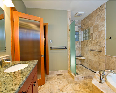 Nevada City bath overview:  Heated travertine floor, granite counters, french doors with beaded glass.  Ten foot ceilings.