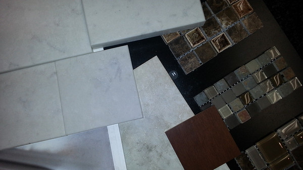 Shower tile and accent tiles with cherry wood cabinet sample.