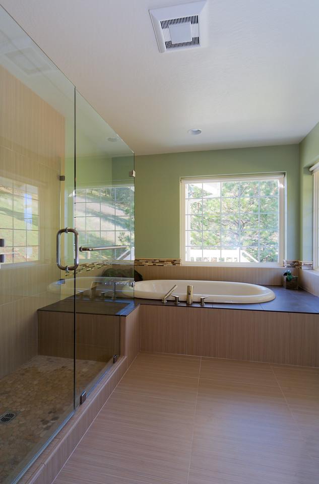 Shuetz Master Bath Frameless shower enclosure on left.