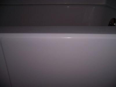 Fiberglass tub -  The same area after repair.