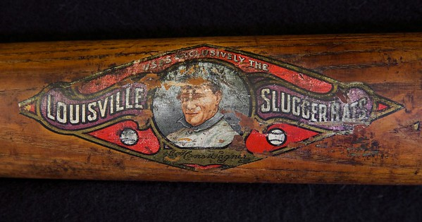 "Louisville Slugger uncracked decal bat; Decal shows near 90% complete; 34"" length and 38oz. Clear grain throughout handle and barrel. Back of barrel is tight and barrel end is intact. Obvious signs of heavy game usage with some cleat marks."