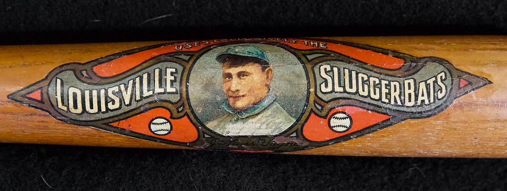 Near flawless decal bat, 22 inch salesman sample bat; Bat is not cracked or damaged in any way, center brand is early era of H&B. Decal is 98% intact. Some chipping near Wagner signature, yet still clearly visible. Face is very clear and fully intact.