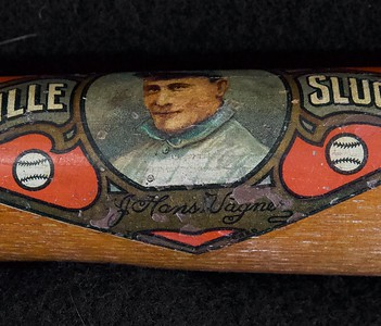 Near flawless decal bat, 22 inch salesman sample bat; Bat is not cracked or damaged in any way, center brand is early era of H&B. Decal is 98% intact. Some chipping near Wagner signature, yet still clearly visible.