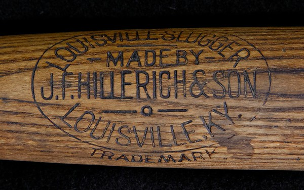 "32 inches and 40 oz Louisville Slugger; Cracked handle on reverse side professionally repaired. Light checking on back of barrel and slight checking on knob.  Pre- ""Ball Balanced"" stamping on barrel."