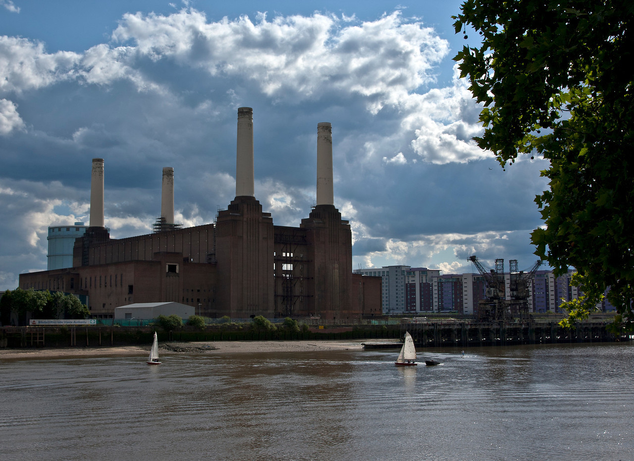 Colour image of sailing boats on the River Thames in front of London's Battersea Power Station