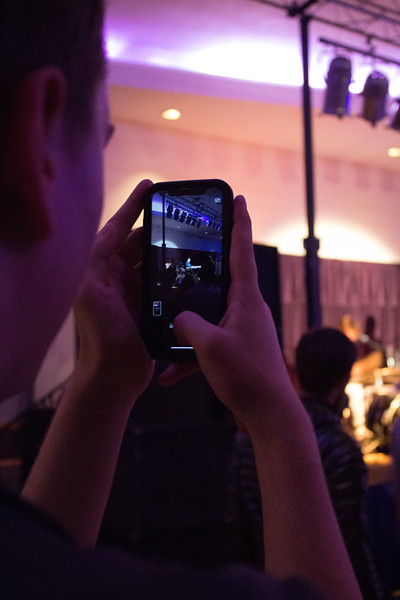 A member of the audience takes a picture of their personal favorite band, Crashing Tonalities.