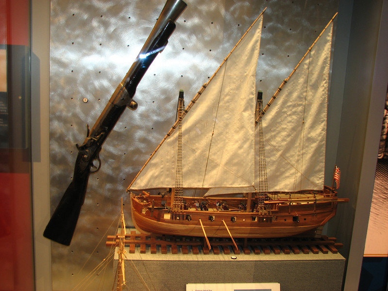Closer view of flintlock swivel gun and ship model.