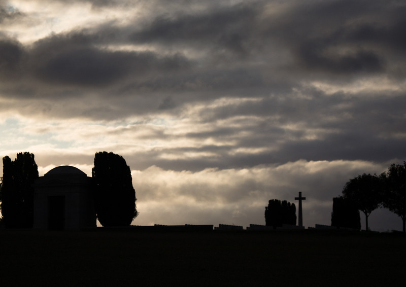 Moody dawn at Mill Road Cemetery, Somme, France.  Because it was positioned over a network of old German trenches and dugouts, the headstones in the original part of the Cemetery are laid flat.