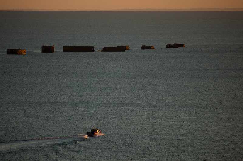 Arromanches - Fisherman among Mulberry Harbour Remains